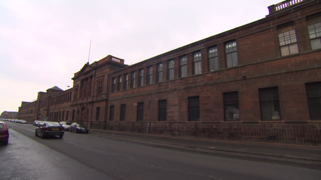 cars pass former shipyard offices filmed in 2014 before being renovated to form the fairfield heritage centre, govan, glasgow, scotland. - 2014 stock videos & royalty-free footage