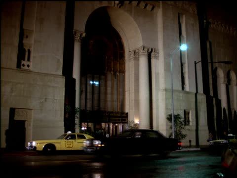 cars pass the entrance at the edison hotel in los angeles, california. - banquet hall stock videos & royalty-free footage
