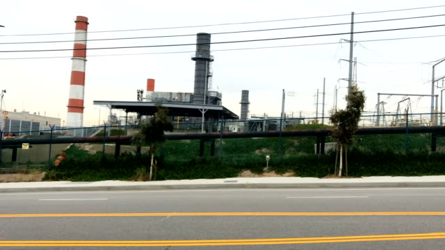 cars pass the scattergood generating station on february 12 2019 in el segundo california the gasfired power plant operates in one of the communities... - el segundo stock videos & royalty-free footage