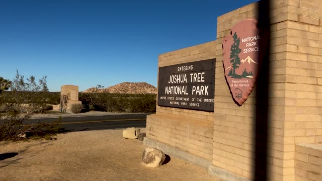 cars pass through joshua tree national park, free of charge, on january 4, 2019 in joshua tree national park, california. campgrounds and some roads... - joshua tree national park stock videos & royalty-free footage