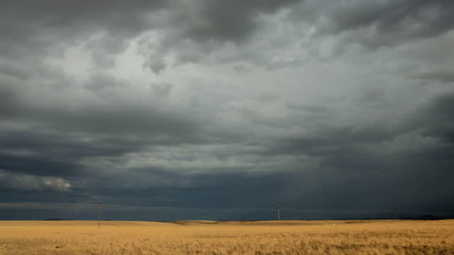 ws t/l cars passing by highway against stormy sky / flagstaff, arizona, usa - flagstaff arizona video stock e b–roll