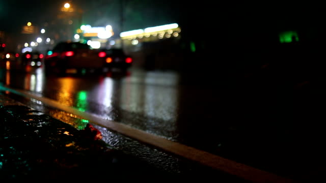 Cars passing by in a rainy night