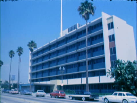 ws cars passing by low-rise office building / los angeles, california, united states - 1966 stock videos and b-roll footage
