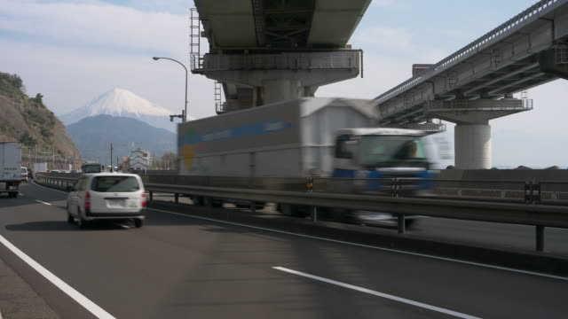 Cars Passing by Mt. Fuji
