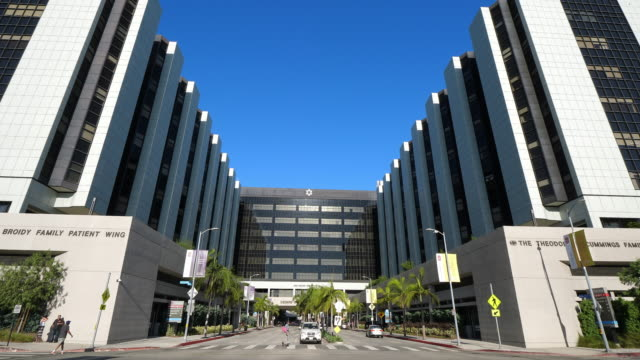 Cars passing Cedars-Sinai Medical Center in Los Angeles California, 4K