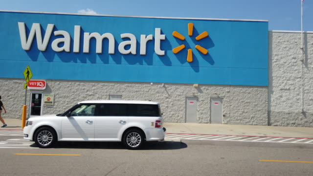 cars passing in front of the walmart shopping center store sign in memphis, tennessee amid the 2020 global coronavirus pandemic - groceries stock videos & royalty-free footage