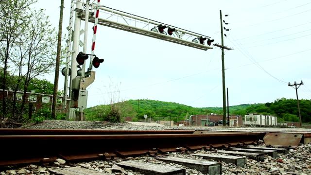 Cars passing railroad crossing