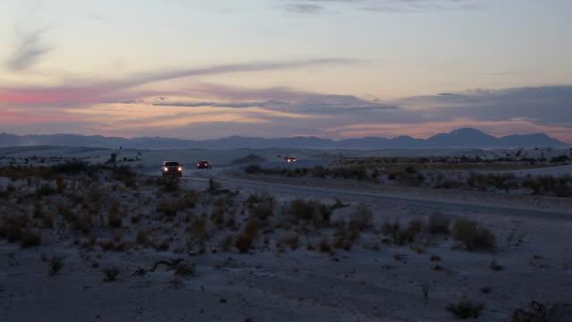 WS Cars passing through desert at night / Santa Fe, New Mexico, United States