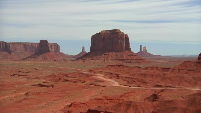 ws cars passing through monument valley / colorado plateau, utah, usa - colorado plateau stock videos & royalty-free footage