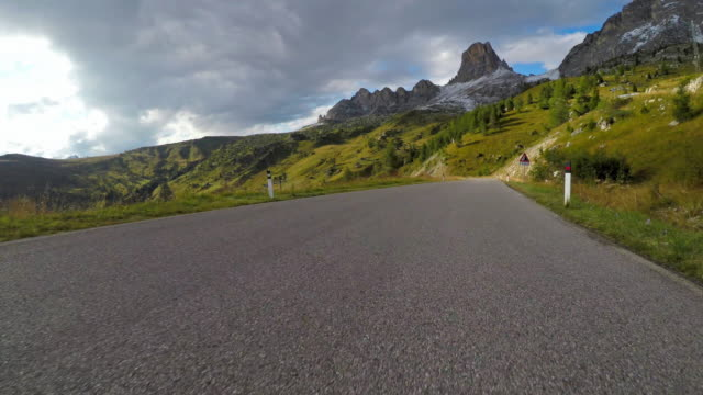 Cars point of view driving down a mountain pass