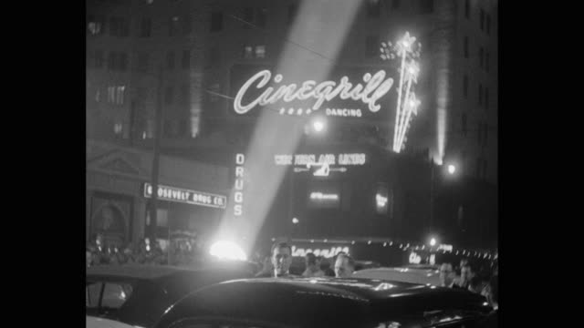 cars pull up in front of grauman's chinese theater, cinegrill at the roosevelt hotel in background. - tcl chinese theatre stock videos & royalty-free footage
