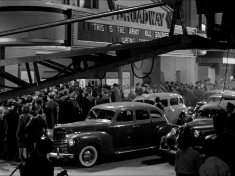 cars pull up to broadway theater director behind camera on crane marquee displays 'this is the army' crowd outside theater military band playing... - film set stock videos & royalty-free footage