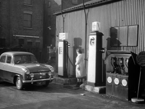 cars pulls into a garage forecourt. - petrol station stock videos & royalty-free footage