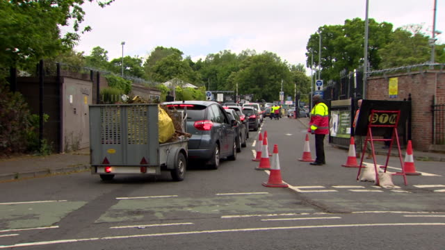 cars queue at recycling centre in belfast as they are reopened after coronavirus lockdown - environmental issues stock videos & royalty-free footage
