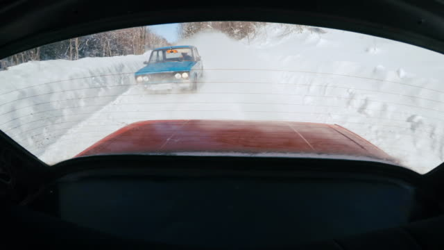 Cars racing against each other on snowbound road