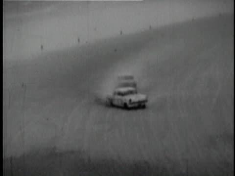 cars racing and crashing at daytona beach course / daytona beech, florida, usa / audio - 1956 stock-videos und b-roll-filmmaterial