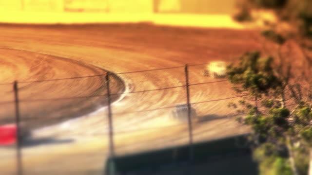 Cars Racing Around Dirt Track