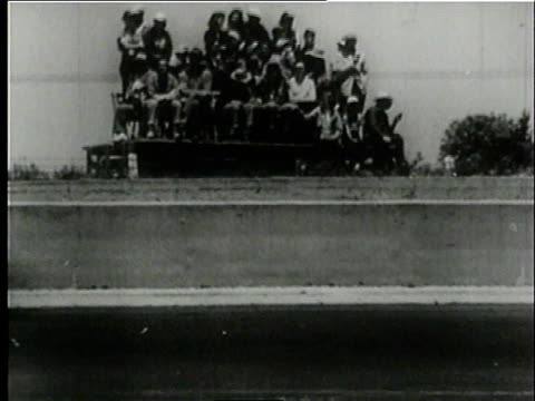 vídeos de stock, filmes e b-roll de cars racing in the national stock car race / langhorne speedway, philadelphia, pennsylvania, united states - 1951