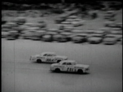 cars racing on track at daytona beach course winner tim flock holding trophy embracing wife and son at awards ceremony / daytona beech florida usa /... - personal land vehicle stock videos & royalty-free footage