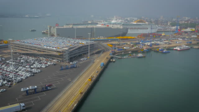 Cars ready for export at Southampton Port, UK filmed by drone