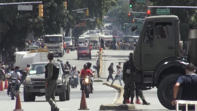 cars remain stuck in traffic jams due to roadblocks manned by venezuelan authorities and random checks performed on drivers to ensure the strict... - caracas stock videos & royalty-free footage
