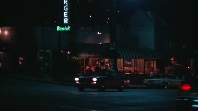 cars riding by hamlet restaurant at night, los angeles - 1967 bildbanksvideor och videomaterial från bakom kulisserna
