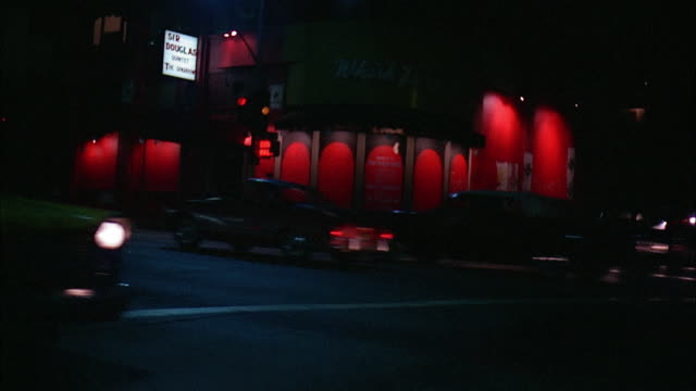 cars riding by whiskey a go go at night, los angeles - sunset boulevard stock-videos und b-roll-filmmaterial
