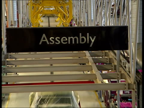 rolls royce factory int unstaffed assembly area of car factory including recently manufactured cars wrapped in plastic incomplete cars waiting for... - bodywork stock videos & royalty-free footage