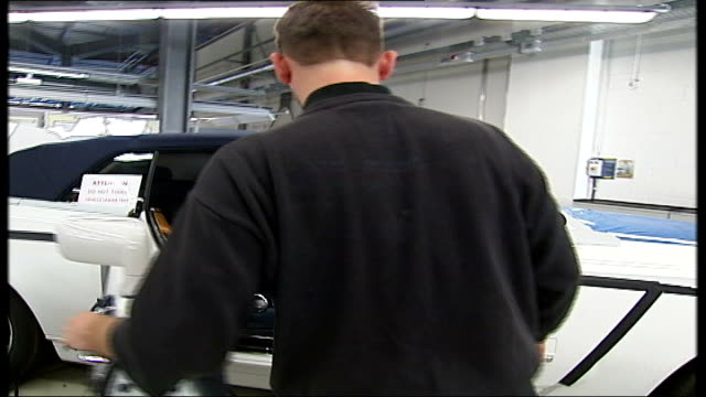 stockvideo's en b-roll-footage met rolls royce new car phantom coupe - preview; close shot monitor showing chassis design engineer checking interior functions and dashboard controls - chassis