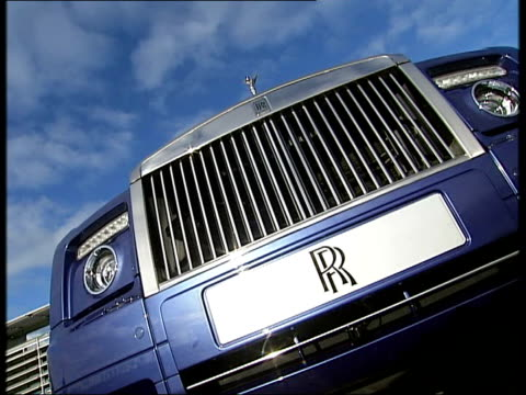 rolls royce phantom coupe more general views of car including rolls royce factory and headquarters building in background low angle view of car... - rolls royce stock videos & royalty-free footage