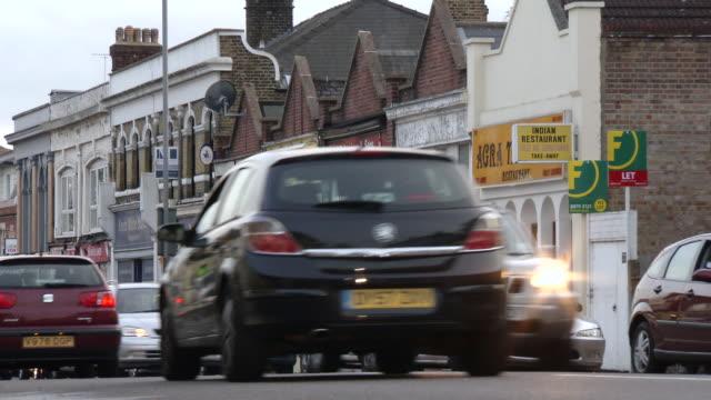 ms cars running on street and restaurants / london, united kingdom - western script stock videos & royalty-free footage