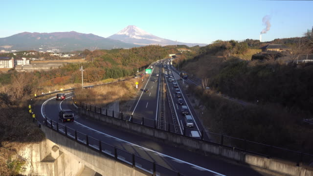 Cars Running on the Motorway with Mt. Fuji in the Background