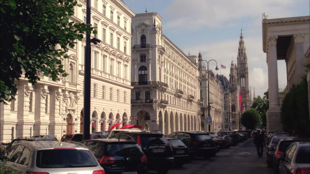 cars sit in a parking lot outside a historic building in vienna, austria. - vienna stock videos and b-roll footage