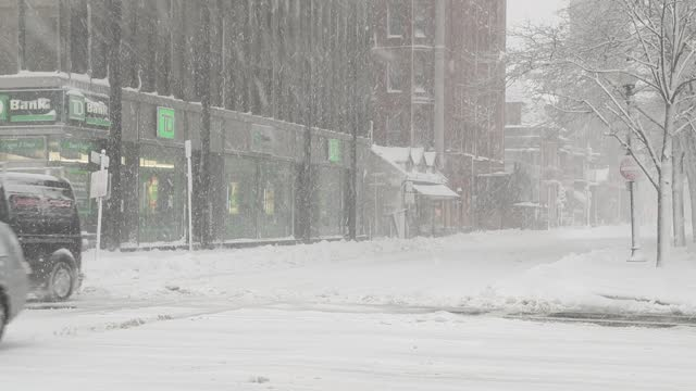 cars slide as they proceed through an intersection as snow blows down boylston. st. on december 17, 2020 in boston, massachusetts. winter storm gail... - major road bildbanksvideor och videomaterial från bakom kulisserna