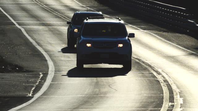 cars speed along road sunset in ohio - ホンダ点の映像素材/bロール