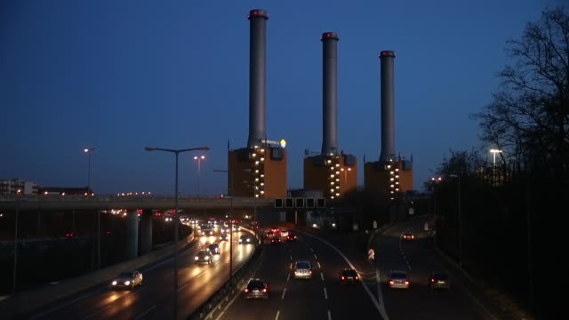 cars speed past a coal-fired power plant operated by swedish energy conglomerate vattenfall on february 25, 2014 in berlin, germany. consumer energy... - nuclear energy点の映像素材/bロール