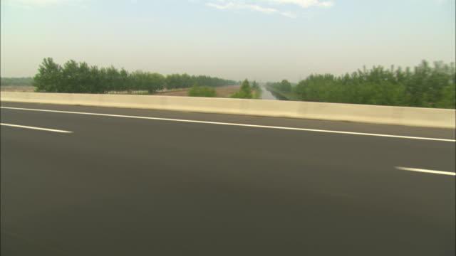 WS POV Cars speeding on highway, Dezhou, Shandong, China