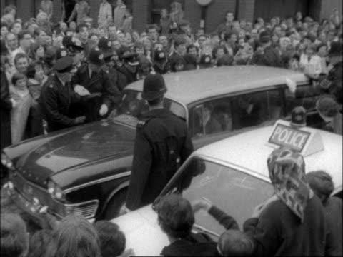 ms car rl through fans ms beatles out rush into building ms ringo wheeled in on stretcher cms john and george cms paul and george ms ringo gets up... - fan enthusiast stock videos & royalty-free footage