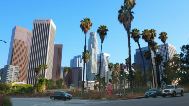 Cars traffic and skyline of Los Angeles Downtown financial and business district, 4K