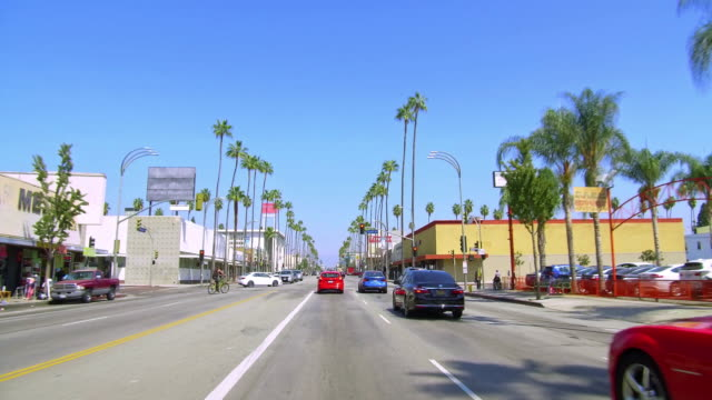 cars traffic on van nuys boulevard in the san fernando valley region of los angeles, california, 4k - 1970 1979 stock videos & royalty-free footage