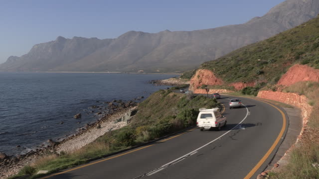 cars travel along a coastal road, south africa - major road stock videos & royalty-free footage