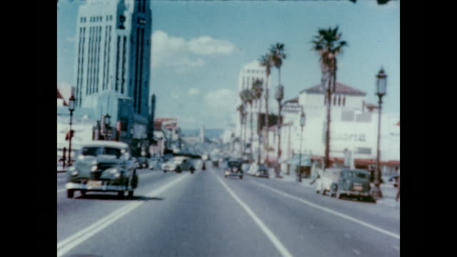 1947 cars travel down wiltshire boulevard in la - 1940~1949年点の映像素材/bロール