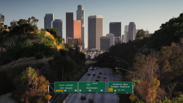 Cars travel into downtown Los Angeles on the Pasadena Freeway.
