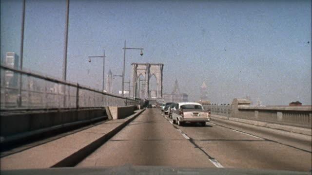 cars travel over the brooklyn bridge; pedestrians cross park avenue. - brooklyn bridge stock videos & royalty-free footage