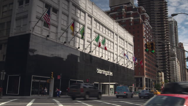 cars travel past bloomingdale's on 59th st and lexington ave - bloomingdales stock videos & royalty-free footage