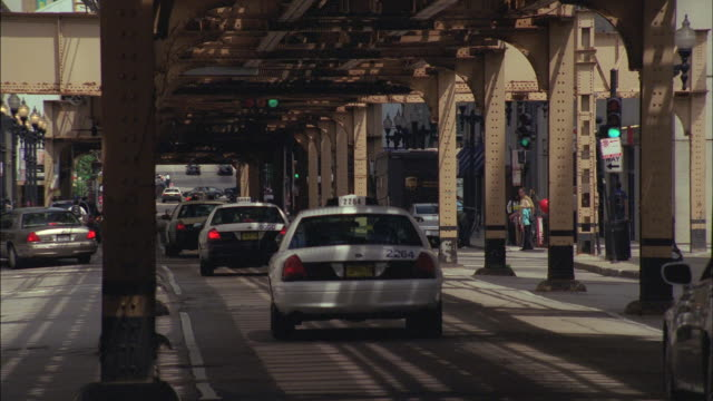 cars travel through the busy streets of chicago. - underpass stock videos and b-roll footage