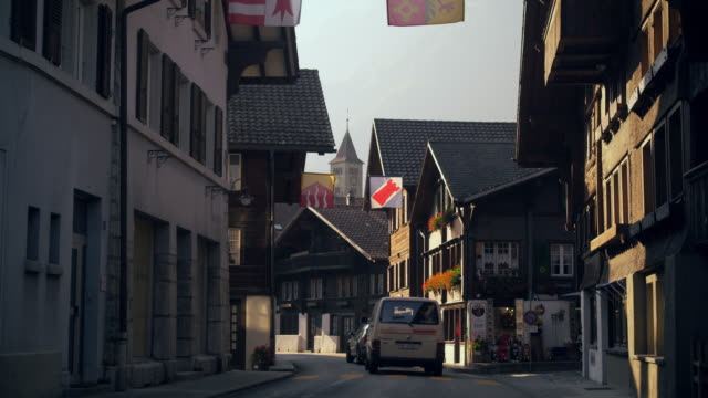 cars traveling down hauptstrasse road, brienz, switzerland - kirche stock videos and b-roll footage