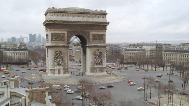 WS Cars travelling around arc de triompe / Paris, France