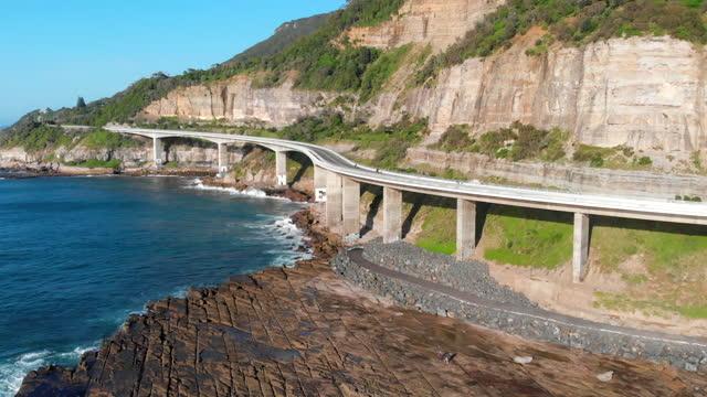 cars traverse the sea cliff bridge, a spectacular coastal road south of sydney, australia - tourism stock videos & royalty-free footage