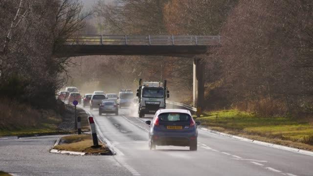 vidéos et rushes de cars vans and trucks on the a9 near invergordon easter ross scotland uk - véhicule utilitaire léger